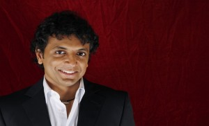 "Director M. Night Shyamalan poses for a portrait during a press day promoting his new film ""The Happening"" in New York June 9, 2008. REUTERS/Lucas Jackson (UNITED STATES) - RTX6P8Q"