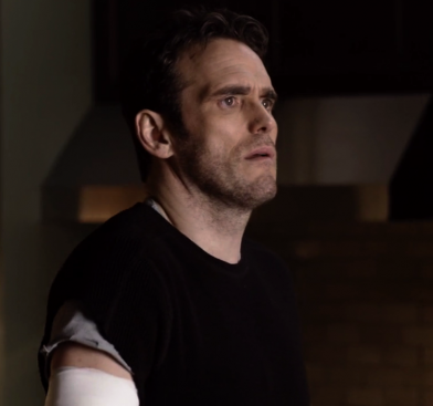 Agent Burke bandaged arm