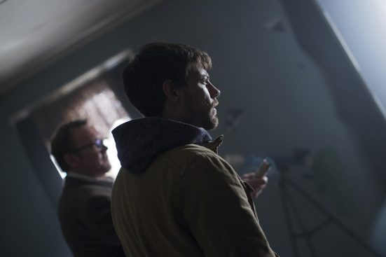 Outcast_101_-_Patrick_Fugit_as_Kyle_Barnes_with_Philip_Glenister_as_Rev_Anderson