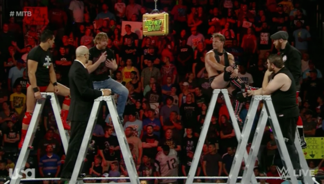 Mr Money in the Bank sat with 5 other men