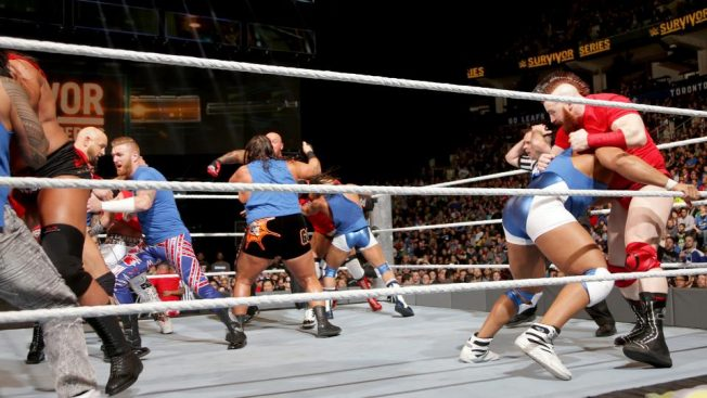 The referee looks on helplessly as an orgy of red and blue breaks out in the ring // wwe.com