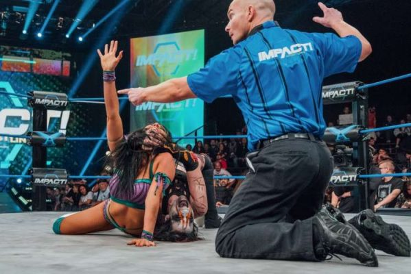 Rosemary puts Santana Garrett in a submission hold