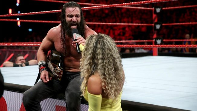 Elias tries to play the guitar mid-match