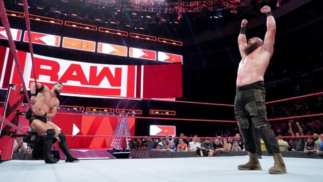Braun Strowman stands tall, Balor in the corner