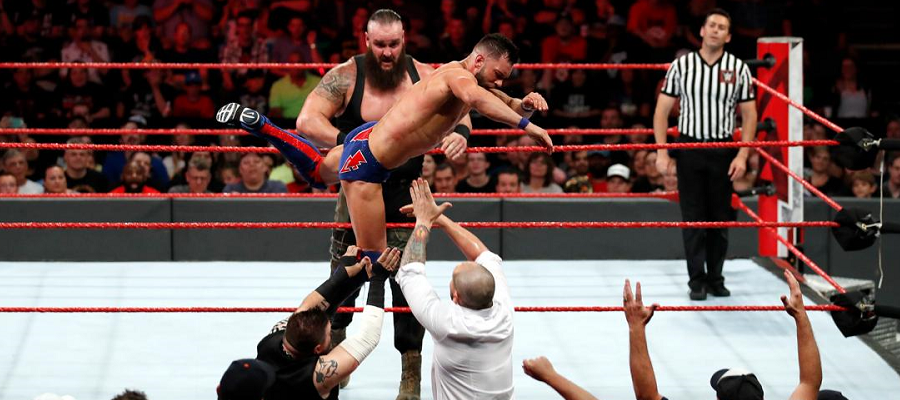 Braun Strowman throws Finn Balor at Baron Corbin and Kevin Owens