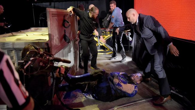 Kevin Owens lies covered in blue liquid