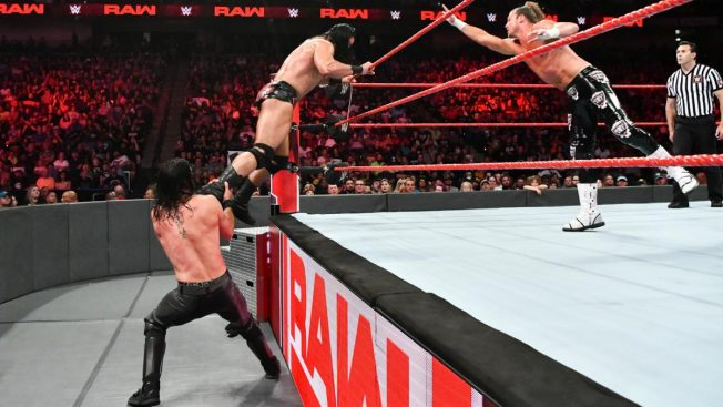 Seth Rollins pulls Drew McIntyre off the apron as Dolph Ziggler goes for a tag