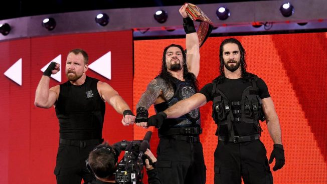 Dean Ambrose, ROman Reigns, and Seth Rollins in Shield pose