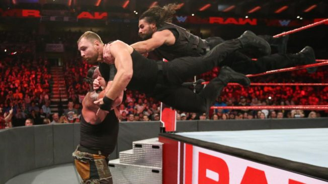 Rollins and Ambrose suicide dive onto Strowman