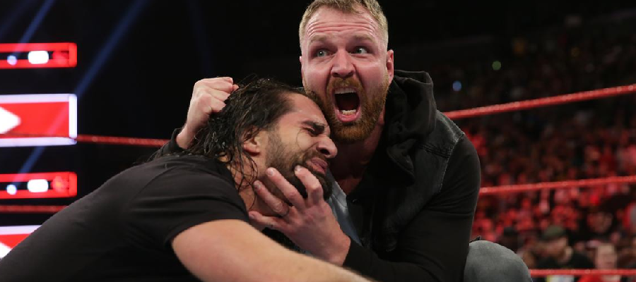 Dean Ambrose holds Seth Rollins' head