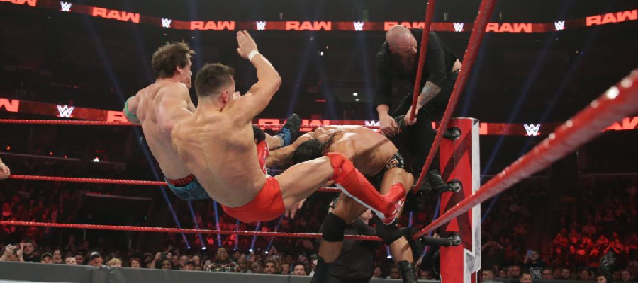 Drew McIntyre slams Finn Balor and John Cena from the corner while Baron Corbin clings on