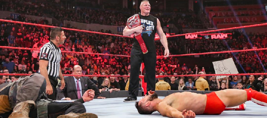 Brock Lesnar stands over Brau Strowman and Finn Balor