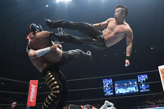 BUSHI is hit by some double team offence