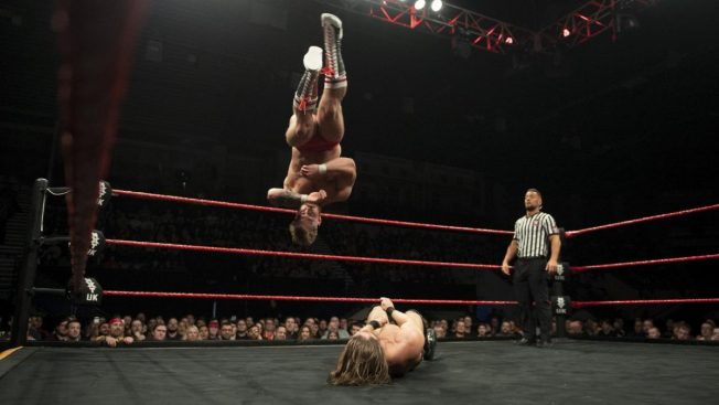 Bate finishes the match with a Corkscrew Senton