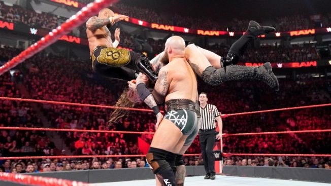Ricochet dropkicks Erik to make him drop Aleister Black