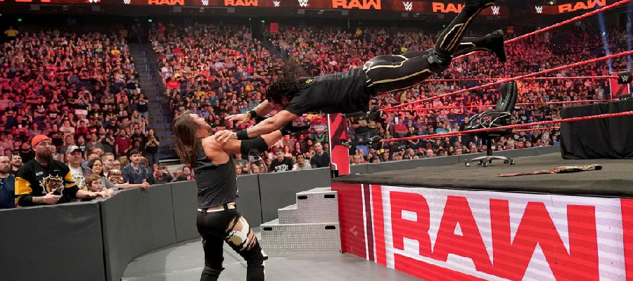 Seth Rollins lands a suicide dive on AJ Styles