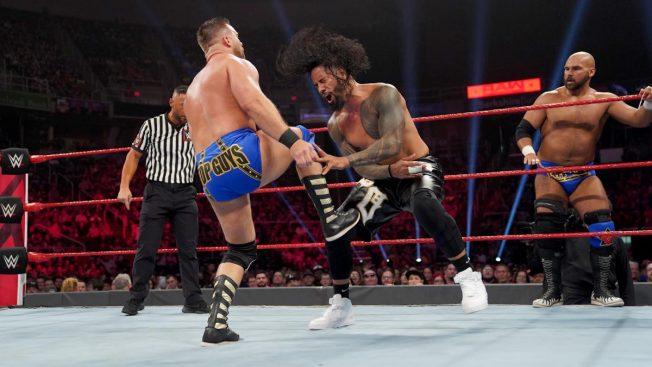 Dash Wilder kicks Jimmy Uso while Scott Dawson watches