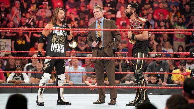 Seth Rollins and AJ Styles argue in front of Vince McMahon