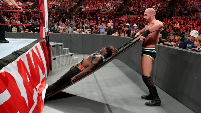 Cesaro with R-Truth on a table