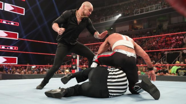 Baron Corbin attacks Rollins while Rollins is beating up Zayn