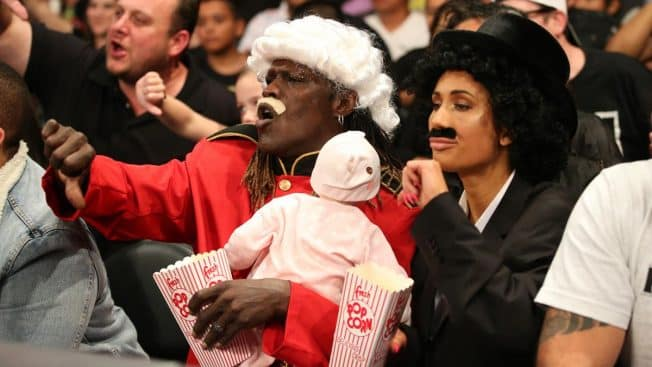 R-Truth and Carmella in disguise in the crowd