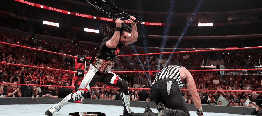 Seth Rollins hits Elias with a chair