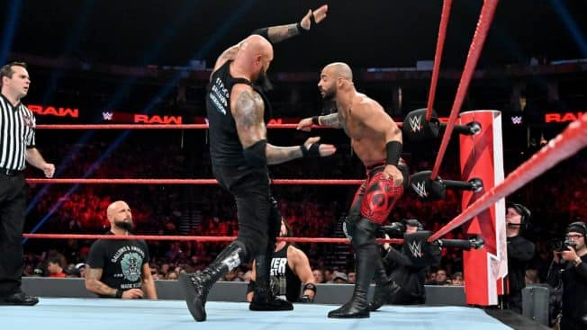 Luke Gallows with Ricochet trapped in the corner