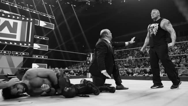 Paul Heyman tries to stop Lesnar's attack on Rollins
