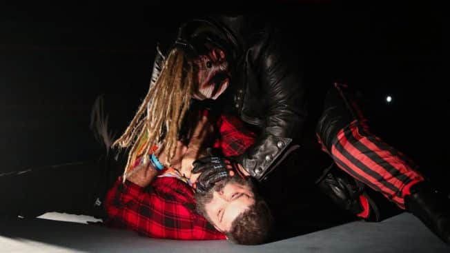 The Fiend chokes out Mick Foley