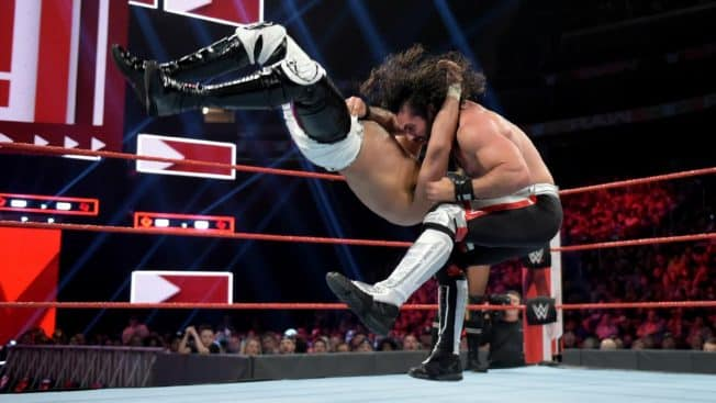 Seth Rollins delivers a Falcon Arrow to Andrade