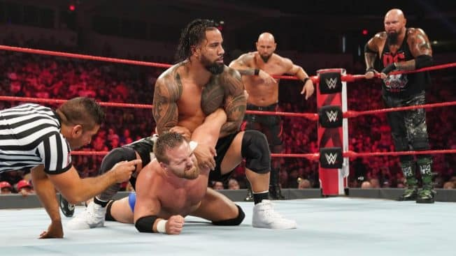Jey Uso controls Dash Wilder with The OC in the backgroud