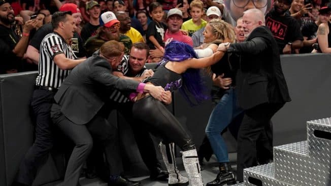 Sasha Banks and Natalya are pulled apart by officials