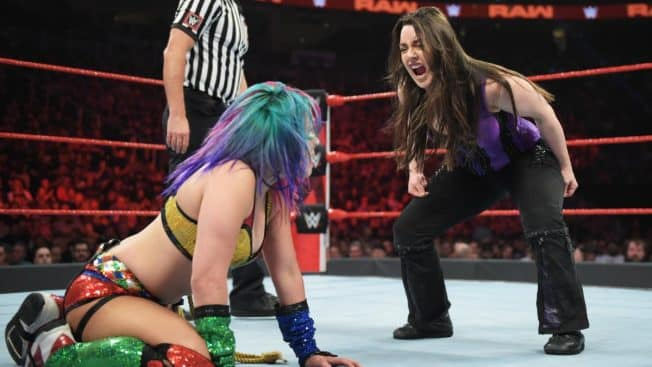 Nikki Cross shrieks at Asuka