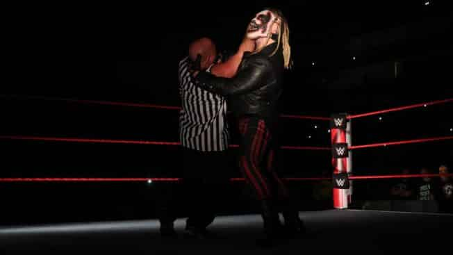 The Fiend grabs Kurt Angle with a mandible claw