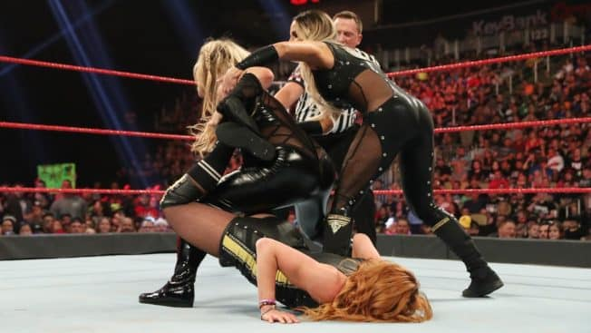 Trish Stratus pulls Natalya off Becky Lynch