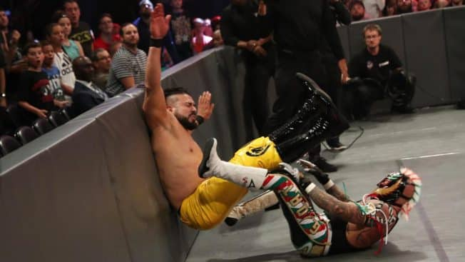 Rey Mysterio sunset flips Andrade into a barricade