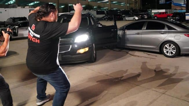 Samoa Joe watches as Roman Reigns' car is T-boned
