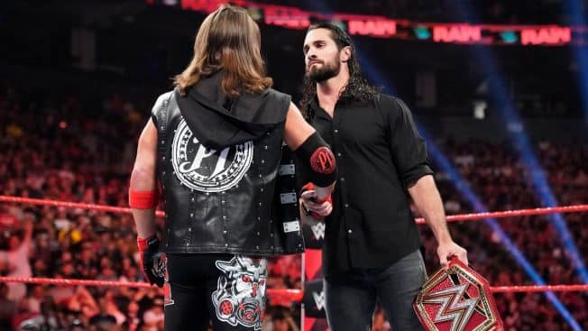 AJ Styles and Seth Rollins shake hands