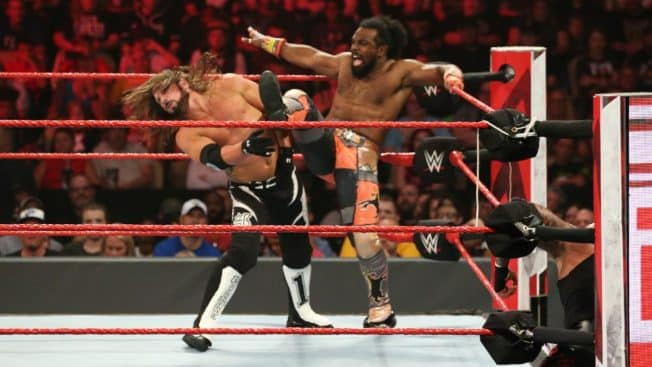 Xavier Woods fends off AJ Styles