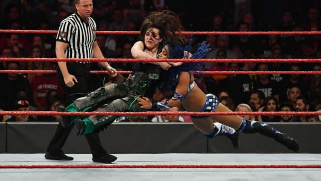 Nikki Cross delivers a running bulldog to Sasha Banks