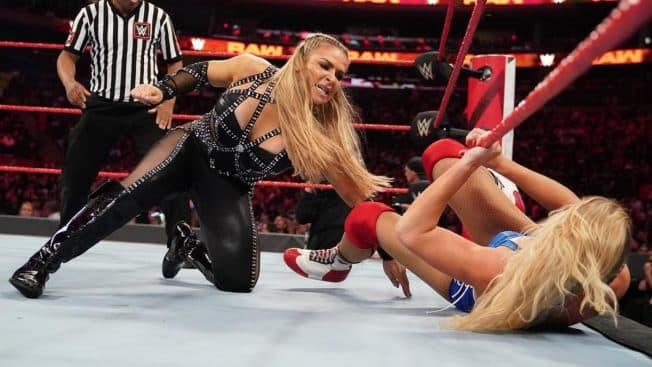Natalya tries to stop Lacey Evans escaping under the bottom rope