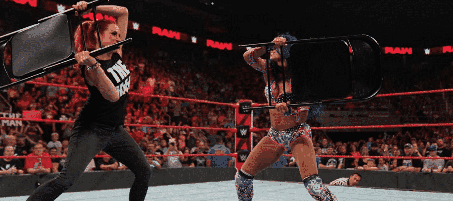 Becky Lynch and Sasha Banks duel with chairs