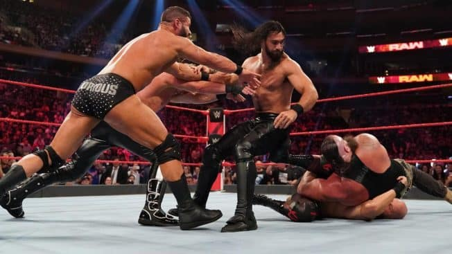 Ziggler and Roode push Rollins onto Strowman