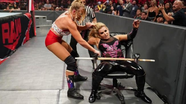 Lacey Evans traps Natalya in a chair
