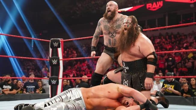 The Viking Raiders stand over Dolph Ziggler