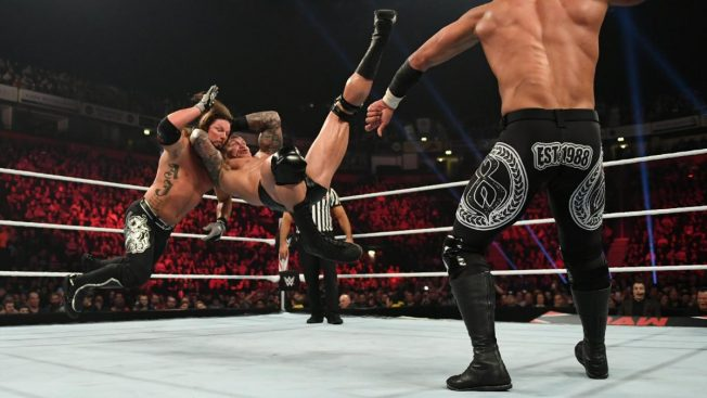 Randy Orton RKO's AJ Styles with Ricochet i the foreground