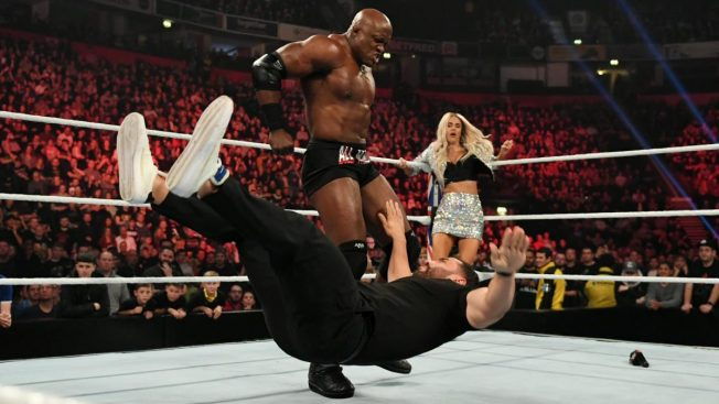 Bobby Lashley knocks down Rusev while Lana watches