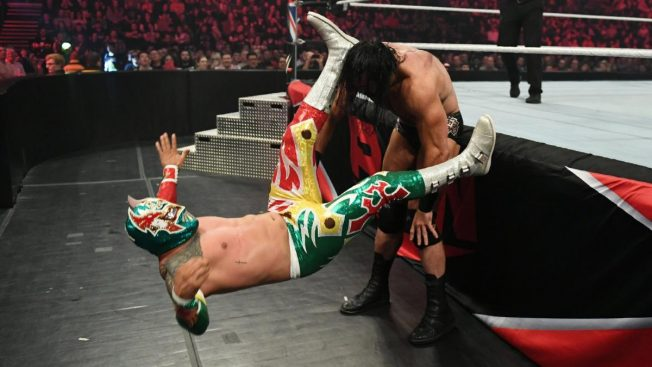 Drew McIntyre powerbombs Sin Cara at ringside