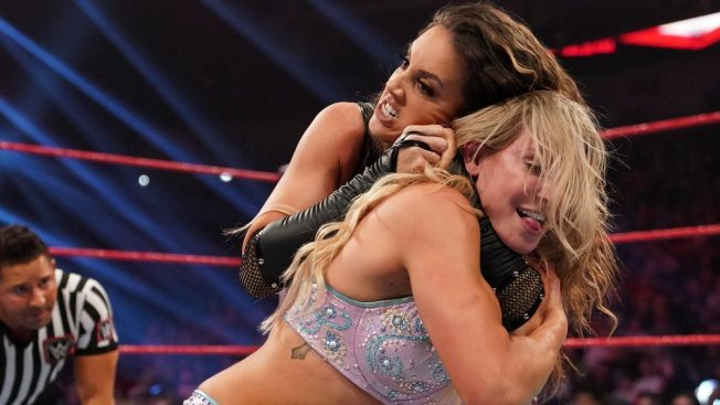 Chelsea Green with Charlotte Flair in a headlock