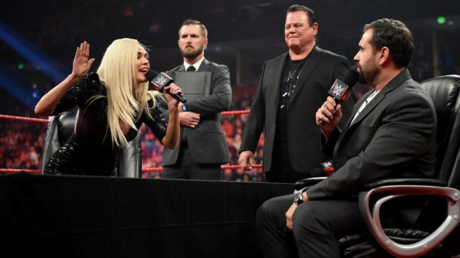 Lana yells at Rusev at the divorce signing. Jerry Lawler watching on